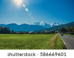 fields with houses and road ... | Shutterstock . vector #586669601