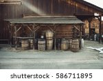 old vintage barrels near retro... | Shutterstock . vector #586711895