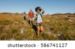 group of young friends hiking... | Shutterstock . vector #586741127