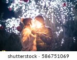 couple with sparklers | Shutterstock . vector #586751069