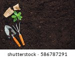 gardening tools on fertile soil ... | Shutterstock . vector #586787291