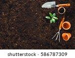 gardening tools on fertile soil ... | Shutterstock . vector #586787309