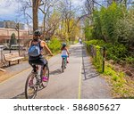 Family bike ride on urban shared path in the city