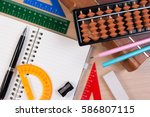pen and abacus over old vintage ... | Shutterstock . vector #586807115