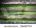 sewage pipes in green water - stock photo