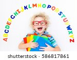happy preschool child learning... | Shutterstock . vector #586817861