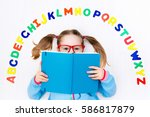 happy preschool child learning... | Shutterstock . vector #586817879