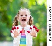 child picking raspberry. kids... | Shutterstock . vector #586819169