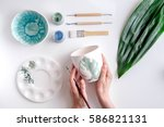 painted ceramic cup on white... | Shutterstock . vector #586821131