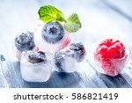 berries frozen in ice cubes... | Shutterstock . vector #586821419