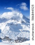 Small photo of Spectacular Alpine view of sunny slopes of a mountain above ski resort