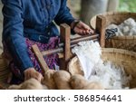 spinning cotton into thread by... | Shutterstock . vector #586854641