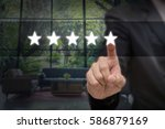 Small photo of Businessman pointing five star symbol to increase rating of company or hotel over blurred of interior lobby background, business evaluation concept, Increase rating
