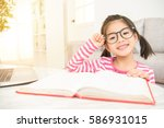 happy child little asian girl... | Shutterstock . vector #586931015