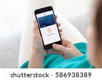 woman holding phone with debit... | Shutterstock . vector #586938389