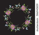 embroidery wreath of flowers.... | Shutterstock .eps vector #586945859