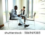 image of two young businessmen... | Shutterstock . vector #586969385