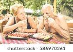 retired couple having fun... | Shutterstock . vector #586970261