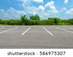 Empty parking lot on blue sky...