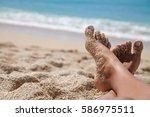 woman tanned legs on sand beach.... | Shutterstock . vector #586975511