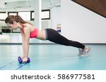 gym woman doing pushup exercise ... | Shutterstock . vector #586977581