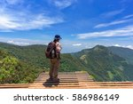 man with hiking equipment... | Shutterstock . vector #586986149