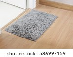fluffy gray doormat on the wood ... | Shutterstock . vector #586997159