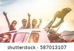 group of best friends cheering...   Shutterstock . vector #587013107