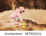 little girl playing with rubber ... | Shutterstock . vector #587020121