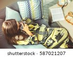 young girl wrapped in blanket... | Shutterstock . vector #587021207