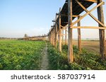 u bein bridge at evening... | Shutterstock . vector #587037914