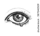 dotwork crying eye. vector... | Shutterstock .eps vector #587040509