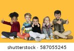 little children thumbs up happy | Shutterstock . vector #587055245