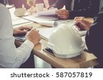 architect and businessman... | Shutterstock . vector #587057819