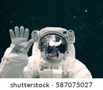 astronaut waves with a hand...   Shutterstock . vector #587075027