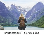 adventure backpacking woman... | Shutterstock . vector #587081165