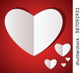 white paper hearts  on red... | Shutterstock .eps vector #587092931