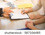 closeup toned of man signing... | Shutterstock . vector #587106485
