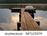 Sunrise On A Small Lake Dock