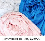 Small photo of Blue White Pink scarves. Scarf isolated on white background, scarf top view. Scarf. Shawl. Beauty. Fashion. Woof. Cloth. Fabric.
