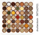 Small photo of Herb and spice sampler in wooden bowls high in vitamins and antioxidants over white distressed wood background.