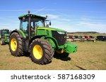 Small photo of KAMEN, CZECH REPUBLIC - September 10, 2013: John Deere tractor on grass field, blue sky on background