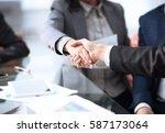 business partnership meeting... | Shutterstock . vector #587173064