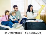 family came to the hotel | Shutterstock . vector #587206205