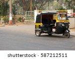 Small photo of Mumbai, India. 16 January 2016. auto-rickshaw, A local transportation of India, waiting for passenger to come on empty road of Mumbai,India