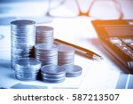 row of coins pen glasses and...   Shutterstock . vector #587213507