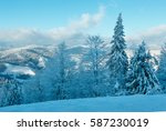the first shadows of setting... | Shutterstock . vector #587230019