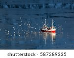 fishing boat and seagulls in... | Shutterstock . vector #587289335