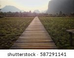 wooden runway in the midst of... | Shutterstock . vector #587291141