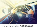 drive car  hands on the... | Shutterstock . vector #587316461